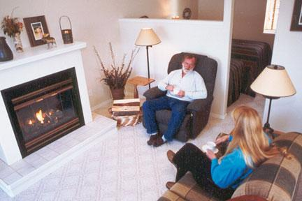 couple sitting in living room of cottage