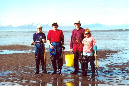 family with bucket digging in the coast