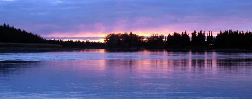 purple sunset over water in Alaska