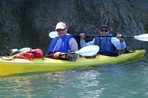 two men in a yellow kayak