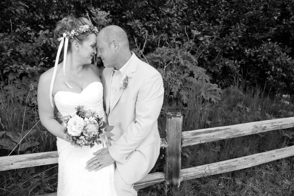 couple hugging at wedding at soaring eagle lodge