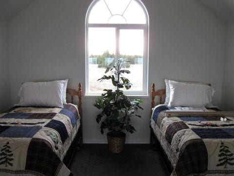 two twin beds in cottage