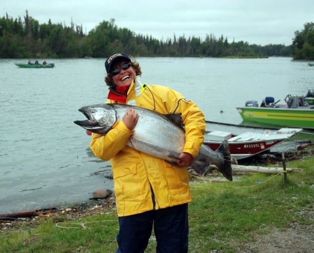 woman holding large salmon