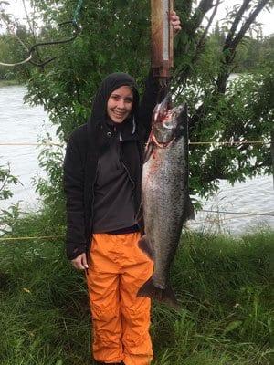 boy holding a salmon