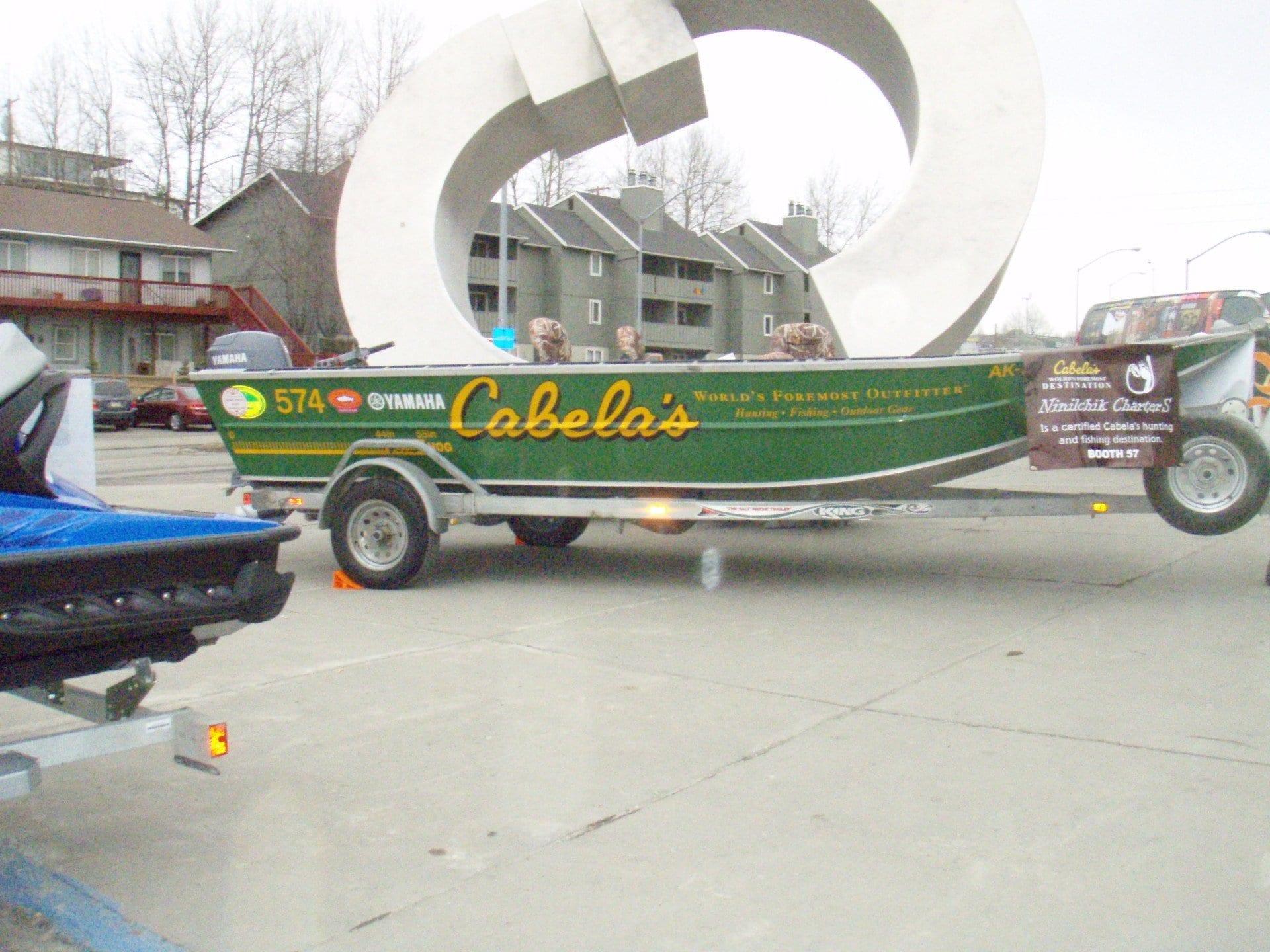 Cabela's green fishing boat