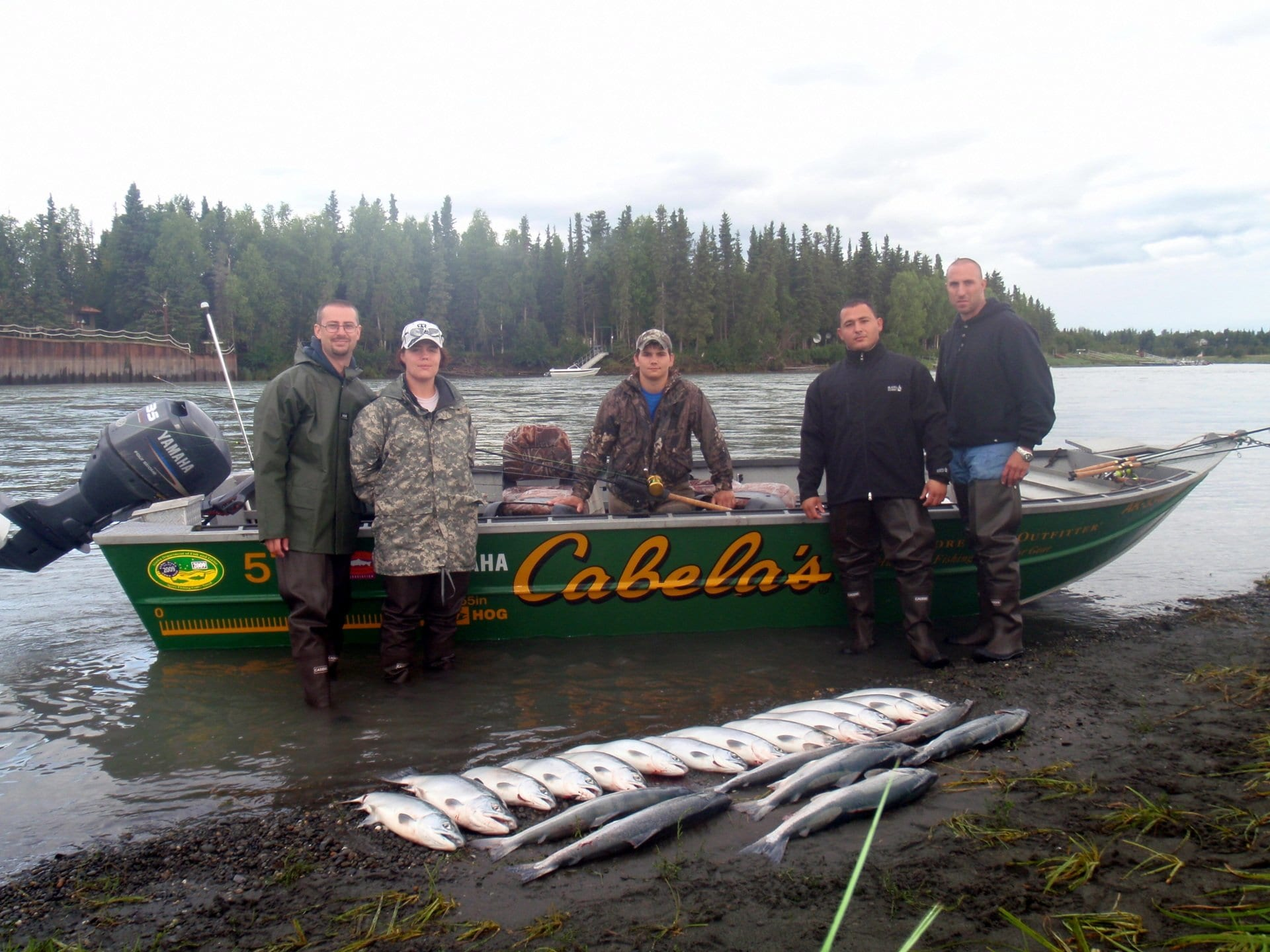 small group of fishers with their catches