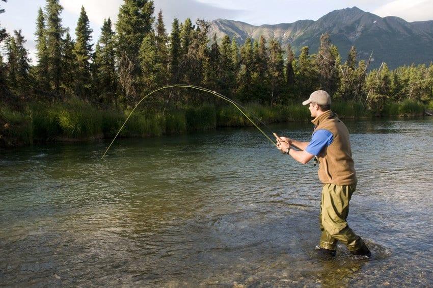 man fly fishing in alaska