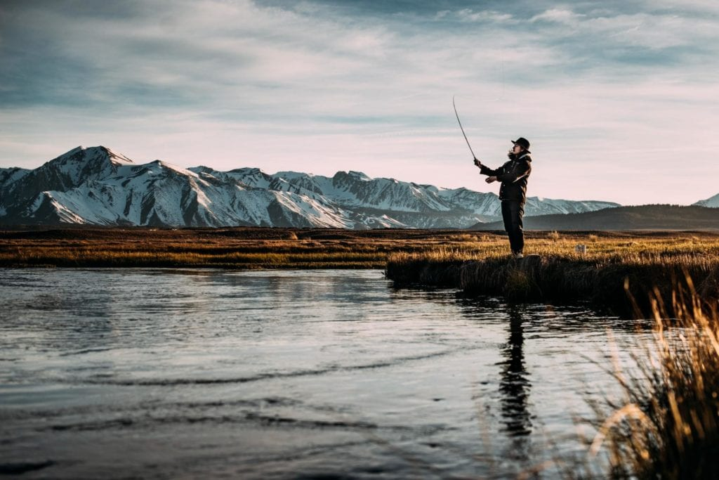 man in hat fishing in Alaska