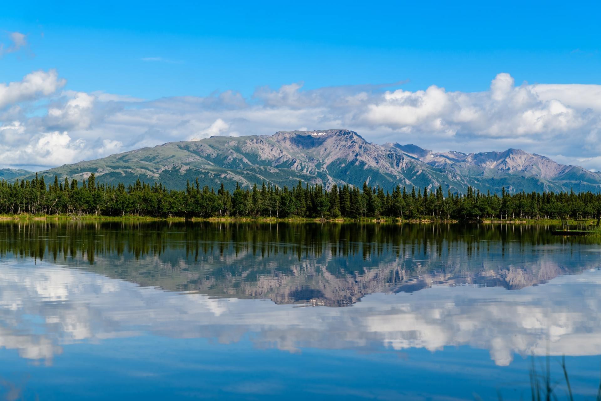 Alaska mountain reflection mirrored in lake
