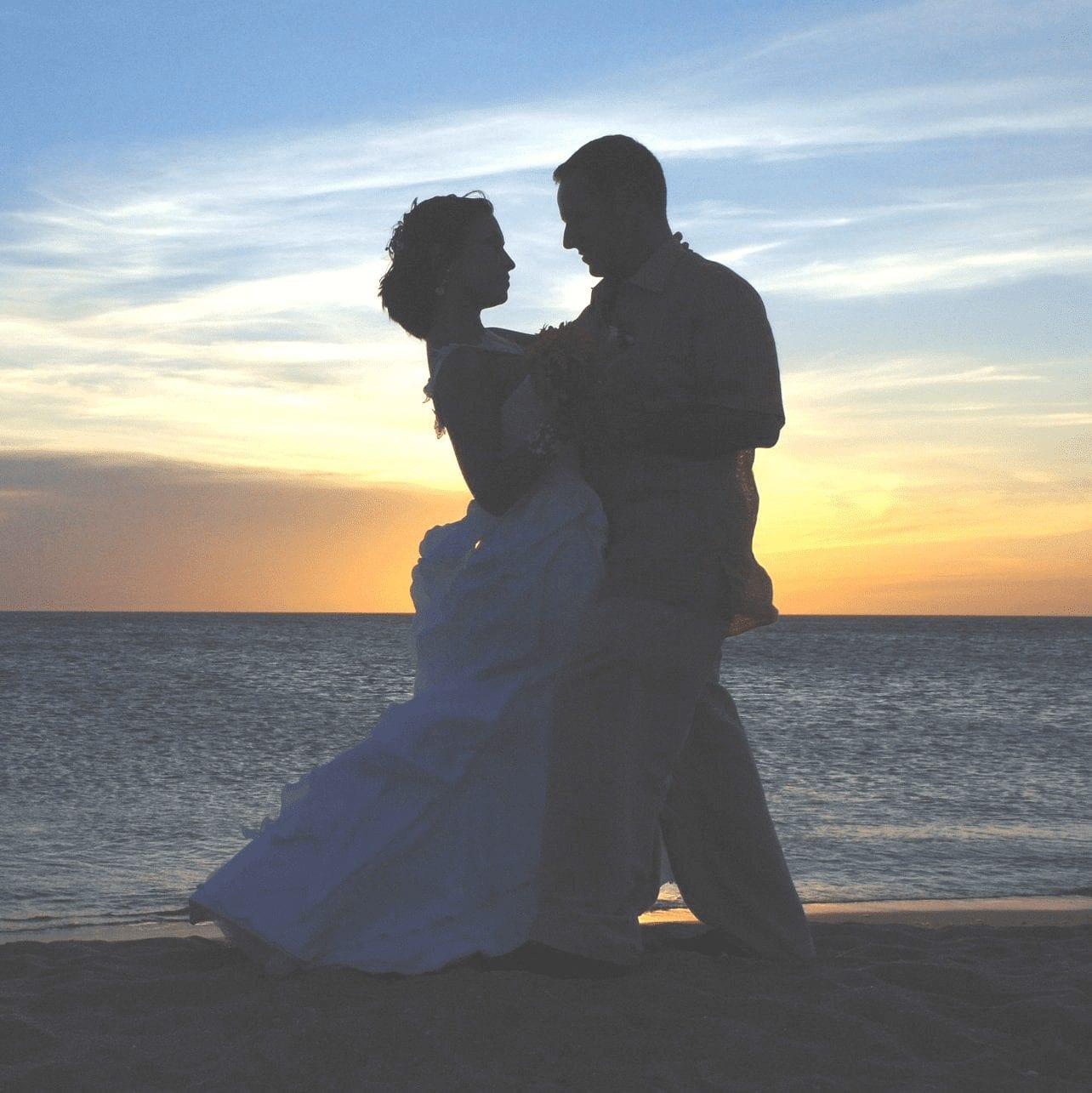wedding couple dancing on Alaska beach