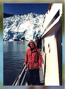 woman in red jacket on a boat at Alaska glacier